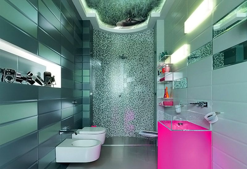 Футуристический проект с фотографической картинкой на потолке. Здесь керамика соседствует со стеклянными вставками. Розовый подиум под раковиной гармонично смотрится в сером окружении