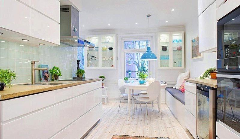 Фото интерьера кухни в скандинавском стиле: простые линии, много света, натуральные материалы