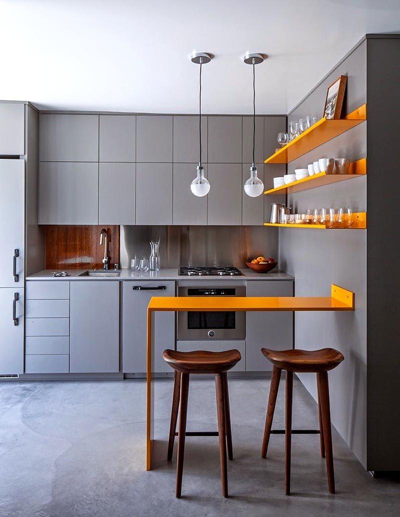 Здесь суровый серый хай тек «смягчен» открытыми оранжевыми полками с прозрачной стеклянной и белоснежно белой посудой