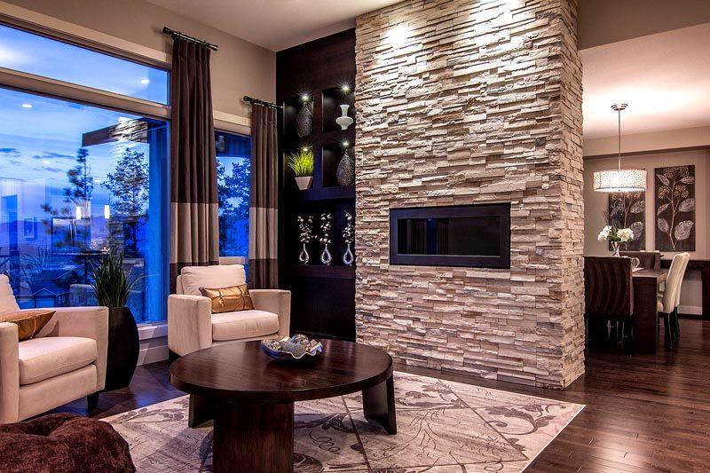 На фото декоративная плитка под камень из цемента для внутренней отделки гостиной