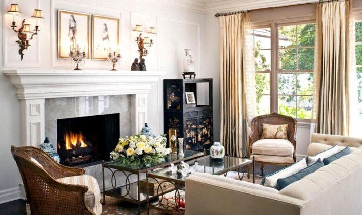 Фото камина в частном доме с увеличенным порталом. Такое решение помогает создать акцент в дизайне без изменения размеров самого дровяного камина