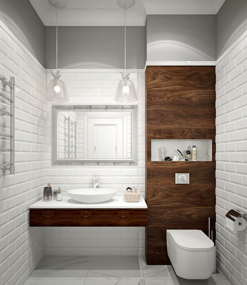 Элементы из светлых пород дерева разбавят монотонный белый цвет ванной комнаты