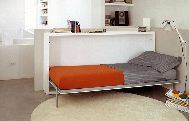 Односпальная кровать в дневное время прячется в небольшую тумбу