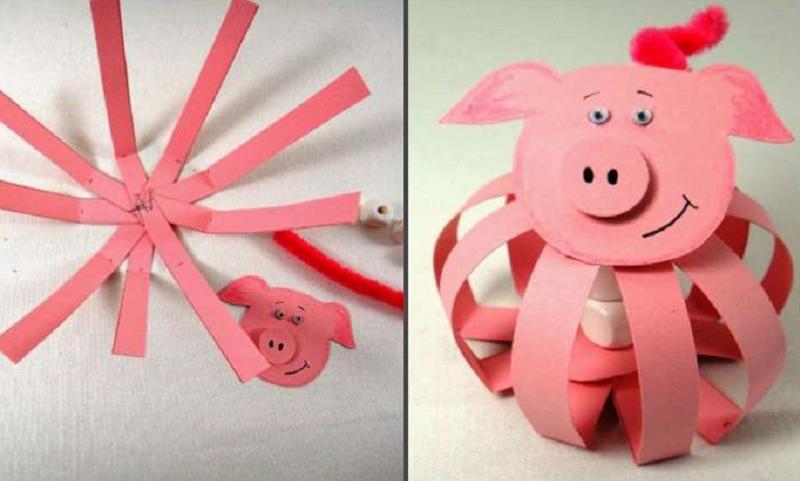 Интересная свинка из полосочек бумаги, которые степлером закреплены у основания. Мордочку можно нарисовать и вырезать самостоятельно