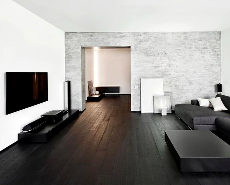 Это белый цвет, серый и чёрный в интерьере, дополненные простотой форм, геометрией прямых и изогнутых линий