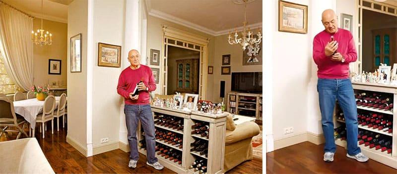 Одну из зон разделяет бар-стеллаж с внушительной коллекцией вина и множеством семейных фотографий