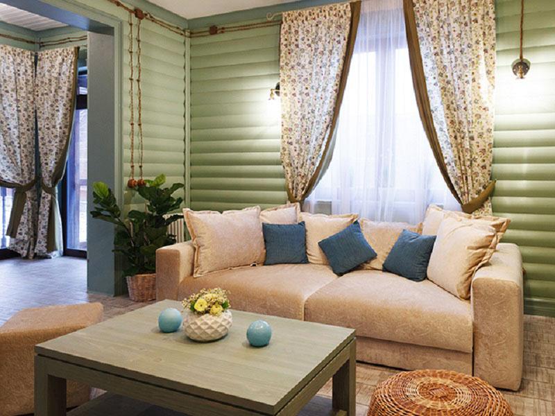 В мягкой зоне установлен диван, каждая секция которого раскладывается по отдельности, а широкие подлокотники могут служить подставкой для подносов