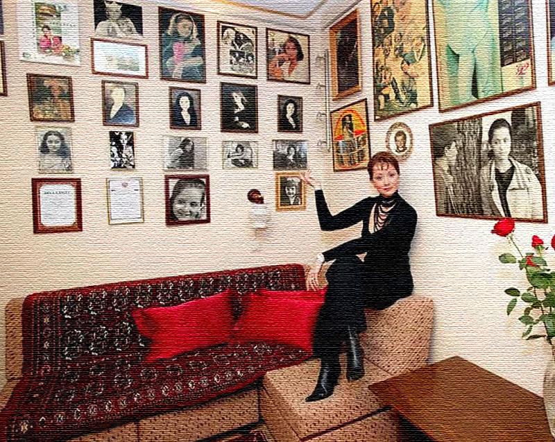 Декоративные подушки алого цвета – единственный яркий акцент в интерьере кабинета Ольги Кабо