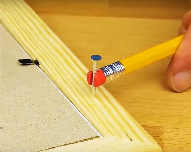 Используйте простой карандаш с резинкой на кончике. Расщепите резинку и вставьте в неё маленький гвоздь. Ваши пальцы будут в порядке