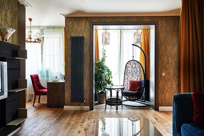В гостиной установили вертикальные радиаторы отопления