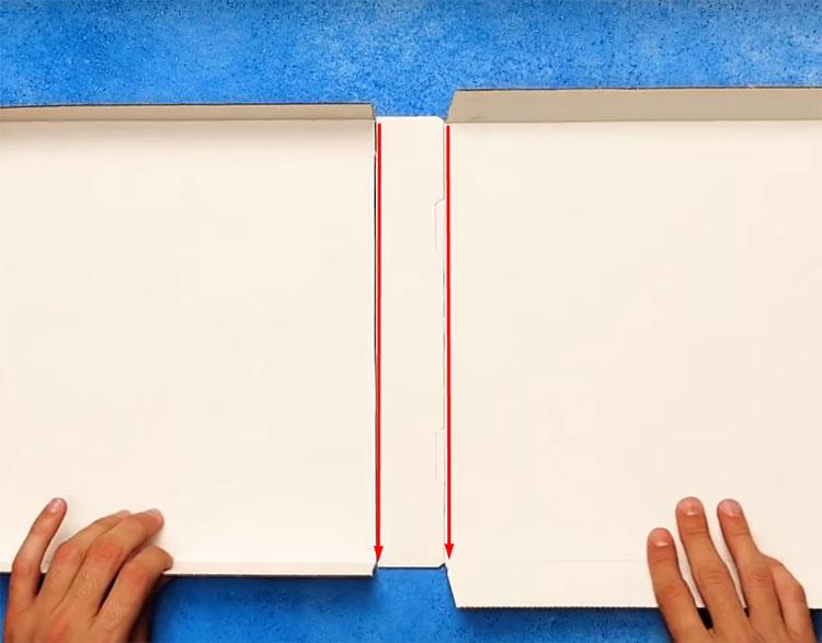 Разрежьте коробку на две части по линиям, указанным на фото. Лишнюю серединку можно выбросить