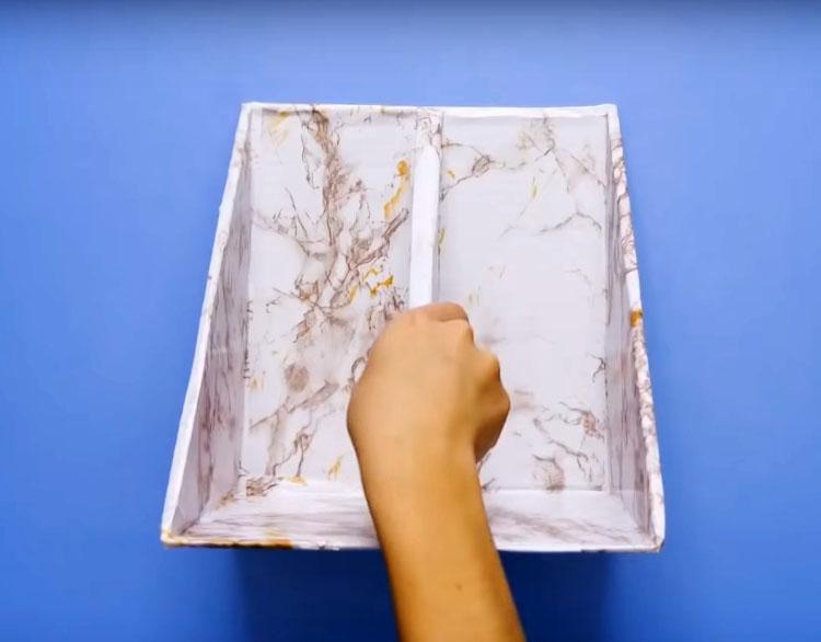 Обклейте их остатками обоев или самоклеящейся плёнкой, предварительно соединив половинки между собой по боковой части