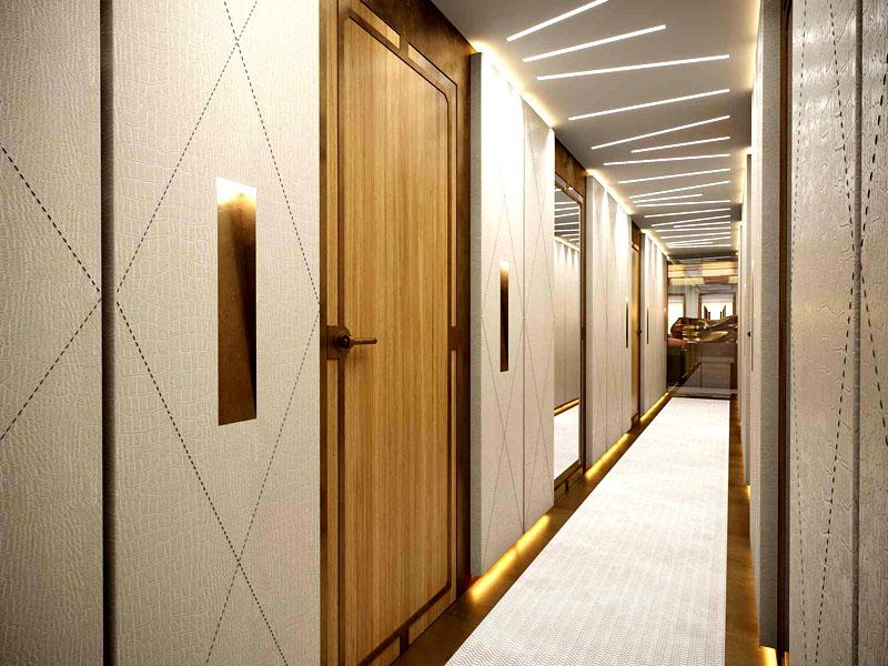 Стены коридора отделаны мягкими панелями с декоративной строчкой и подсвечены снизу