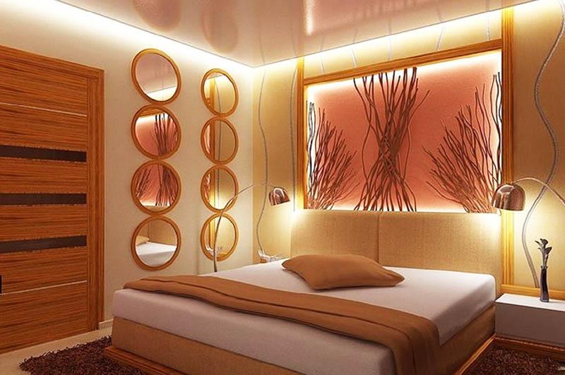 Необычное и красивое решение – использование внутренней подсветки для картины или декоративной панели на стене