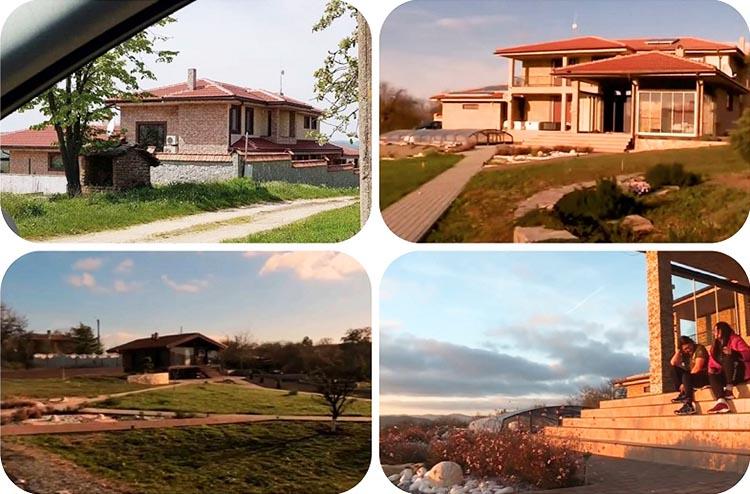 Двухэтажный дом со всех сторон обнесён бетонным забором