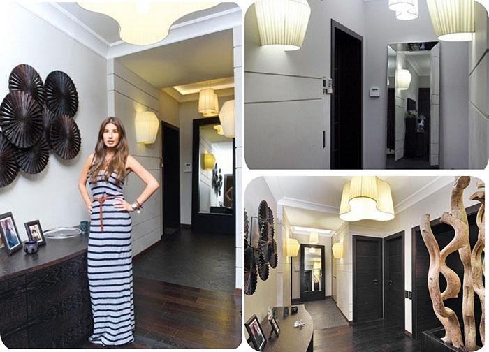 Стерильный интерьер прихожей разбавляют чёрная входная дверь и огромное напольное зеркало