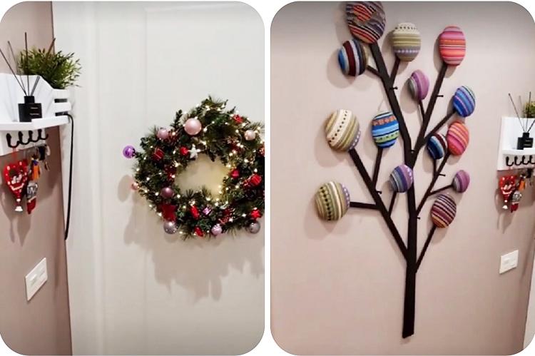 Просторный холл украсили к первому в этой квартире Новому году рождественским венком и красивым деревом ручной работы